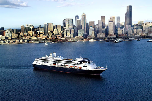 Holland-America-Amsterdam-in-New-York - MS Amsterdam in New York Harbor. The Holland America ship offers a diverse set of itineraries, including Grand World Voyages, Grand Pacific and Far East Voyages and sailings to Panama, the Southern Caribbean and Incan Empires.
