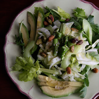 In a Crunch Celery Fennel Slaw with Ginger over a Bed of Arugula.