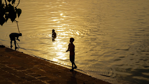 Sunset bath by Caesar Jees - People Street & Candids ( water, sunset, silhouette, street, bath, people, culture, city, river,  )