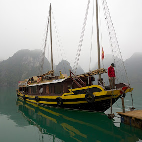 A Prayer by Christopher Harriot - Transportation Boats ( prayer, emerald, journey, sea, halong bay, boat, man )