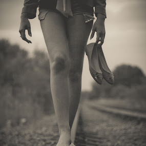 One the Line by Bryn Graves - People Body Parts ( shoes, distance, railway, railroad, legs, travel,  )