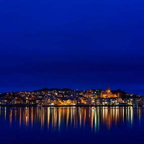 Kristiansund at night. Norway. by Paulius Bruzdeilynas - Landscapes Waterscapes ( lights, water, dark, reflections, night, trip, travel, cityscape, travel photography, kristiansund, norway, city, serenity, blue, mood, factory, charity, autism, light, awareness, lighting, bulbs, LIUB, april 2nd,  )