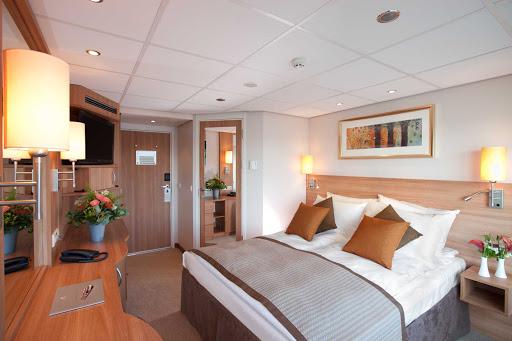 Viking-Prestige-Deluxe-Suite - Settle into a comfortable Deluxe Suite aboard Viking Prestige during your  Danube River cruise.