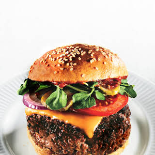 Triple-Beef Cheeseburgers with Spiced Ketchup and Red Vinegar Pickles.