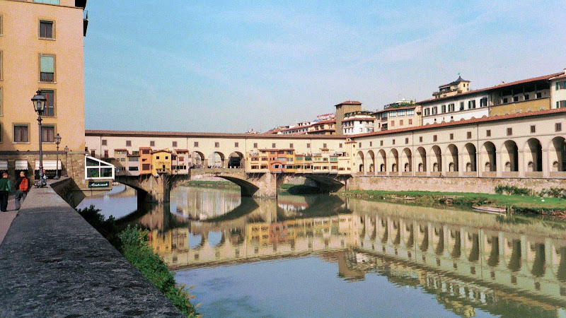 The Ponte Vecchio (Italian for Old Bridge) is a medieval bridge over the Arno River in Florence.