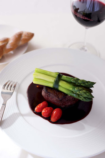 Culinary-Experiences-Steak-Dinner-Entree-1 - Steak is paired with tomatoes and asparagus for a main entrée aboard Crystal Serenity.