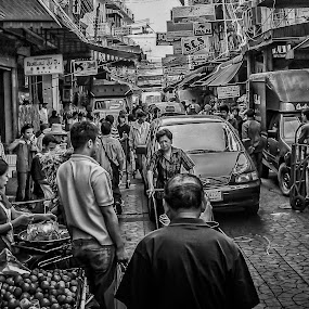 Facing life by Barb Hauxwell - Black & White Street & Candid ( trucks, signs, packages, bikes, fun in the street, boxes, cooking, oranges, vietnam, street scene, people, downtown )