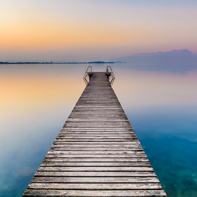 The stillness of the Lake Garda by Roberto Melotti - Landscapes Waterscapes ( calm, roberto melotti, smooth, calmness, nikon d7100, gangway, stillness, landing stage, quiete, sunset, pier, sirmione, lake garda, tranquility, wharf, italy,  )