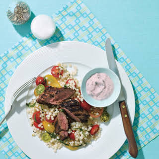 Grilled Lamb Loin With Tomato and Cucumber Raita and Israeli Couscous.