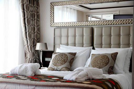 AmaCerto-suite-bedroom - Relax in your  AmaCerto suite as you sail down the Rhine River and explore the passing landscapes.