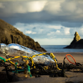 All washed up by Brian Miller - Landscapes Beaches ( flotsam, wales, beach, bottle, coast,  )