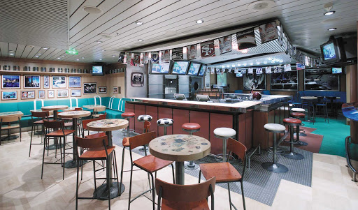 Explorer-of-the-Seas-Weekend-Warrior - The Weekend Warrior sports bar aboard Explorer of the Seas  offers sports lovers an array of large-screen TVs so you won't miss your favorite team.