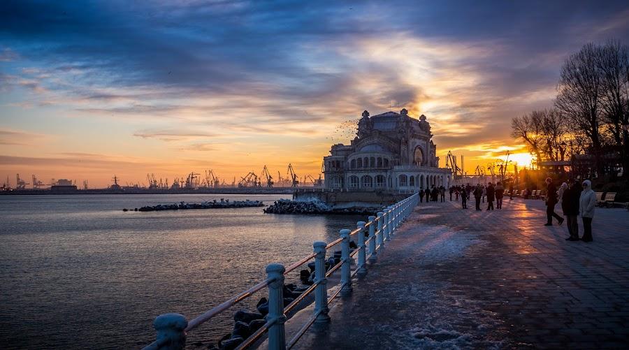 Constanta Casino by Adrian Ioan Ciulea - Buildings & Architecture Other Exteriors ( building, cranes, sky, waterscape, sunset, sea, casino, old building, sun, , golden hour, sunrise )