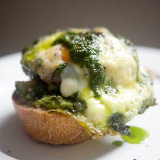 Roasted Portabello Mushroom Baked with Egg, Pesto and Cheddar.