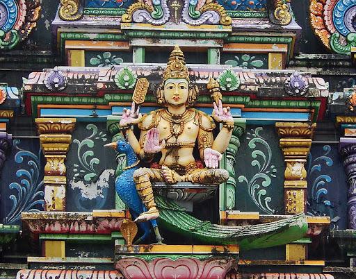 god-four-arms-nadi-fiji - A Hindu deity at the Sri Siva Subramaniya temple Nadi on the main island of Viti Levu, Fiji.