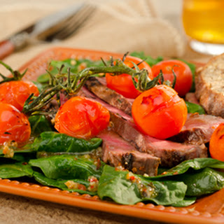 Spinach Salad With Pan Roasted Sirloin And Vine Tomatoes.