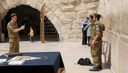Soliders-at-Western-Wall - Israeli soldiers pose for photos at the Western Wall in Old Jerusalem.