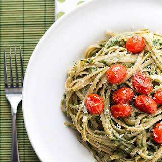 Creamy Spinach and Avocado Pasta with Roasted Tomatoes.