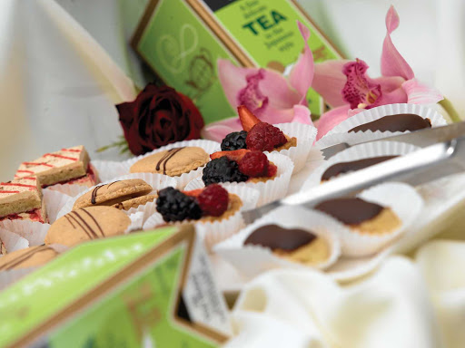 Oceania-High-Tea-2-1 - Satisfy your sweet tooth with colorful petit fours, delicate pastries and a selection of teas during your travels on Oceania Regatta.