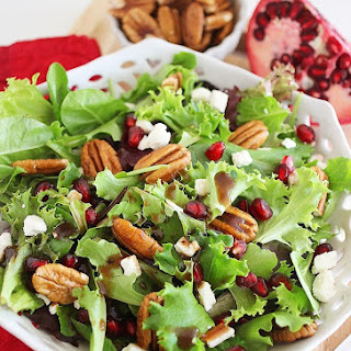 Mixed Green Salad with Pomegranate Seeds, Feta and Pecans.