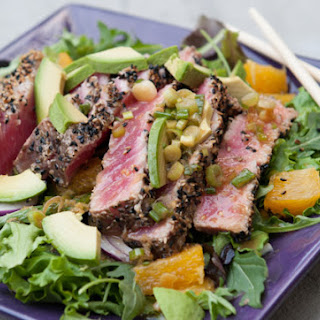 SESAME-CRUSTED SEARED ASIAN TUNA OVER SALAD GREENS