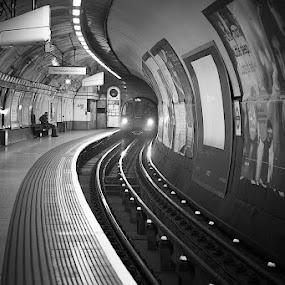 it's here by Karen Shivas - Black & White Street & Candid ( tube, white, rail, people, black )