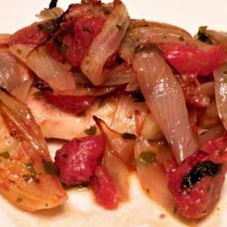 Griekse Kabeljauw plaki met tomaten en uien
