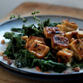 Chili, Lemon And Herb Roasted Tofu With Kale And Pine Nuts.