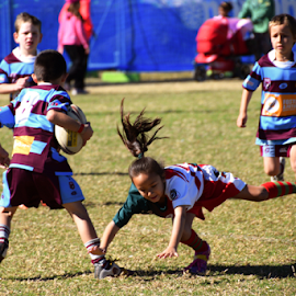 Falling Girl by Linda Taylor - Sports & Fitness Australian rules football ( playing, child, girl, football, children, sport, falling, footy,  )