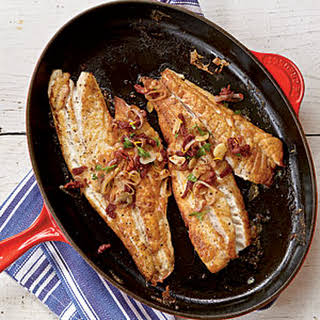 Pan-Roasted Snapper Fillets with Sun-Dried Tomatoes and Garlic.