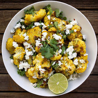 Roasted Curry Cauliflower with Feta and Cilantro.