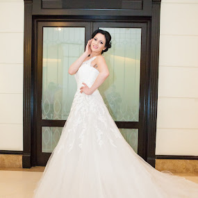 Wedding dress is both an intimate and personal for a woman by Paul Padurariu - Wedding Bride ( wedding dress, bride, gate )