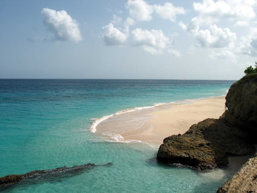 beach-and-sea-Anguilla - Beach meets the sparkling waters of Anguilla. Travelers visit for its natural beauty, quiet atmosphere and 33 pristine beaches.