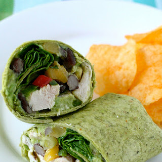 Roasted Chicken Wraps with Black Bean Salsa and Guacamole.