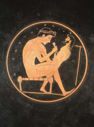 Kylix, a sculptor working on a herm