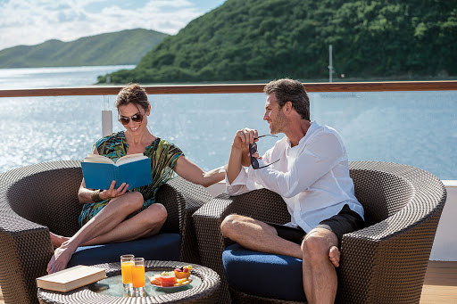 Tere-Moana-sundeck-company - Have a fruit plate and drink and curl up with a book on the sundeck of Tere Moana.