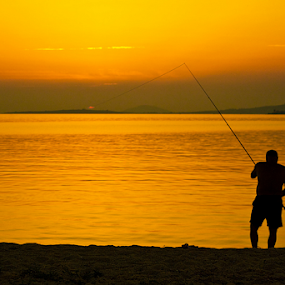 The suncatcher by Goran Kojadinovic - Digital Art People ( vacation, suncatcher, silhouette, sunset, greece, sea, fisherman, sun, golden hour )