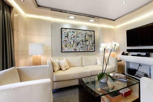 The classically designed Vista Suite lounge area aboard Oceania Riviera.