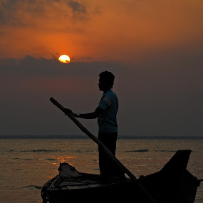 Ending  by Qamrul Hassan Shajal - Landscapes Sunsets & Sunrises ( water, red, bangladesh, boatman, sunset, beautiful, cahdpurr, boat, sun, man, river )