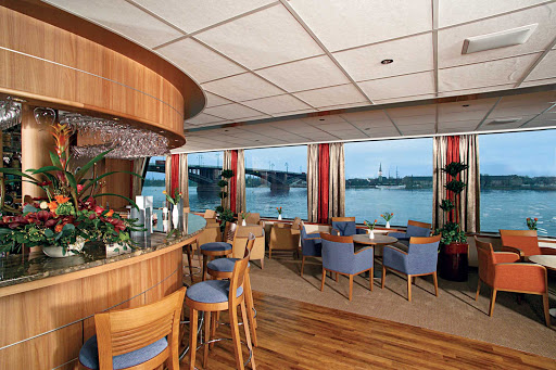 Viking-Helvetia-Sun-Lounge-Bar - Guests can enjoy a pre-dinner drink while admiring the scenic landscapes along the Rhine River aboard Viking Helvetia.