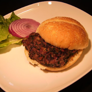 Beef Burger with Spinach, Roasted Poblanos, and Caramelized Onions.