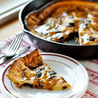 Roasted Cherry Dutch Baby with Brown Sugar-Cinnamon Sauce