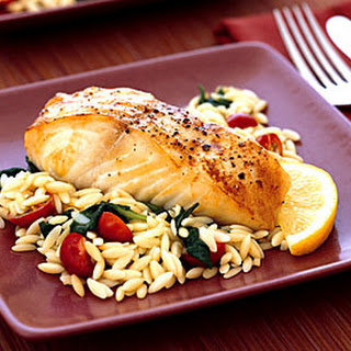 Baked Halibut with Orzo, Spinach, and Cherry Tomatoes.
