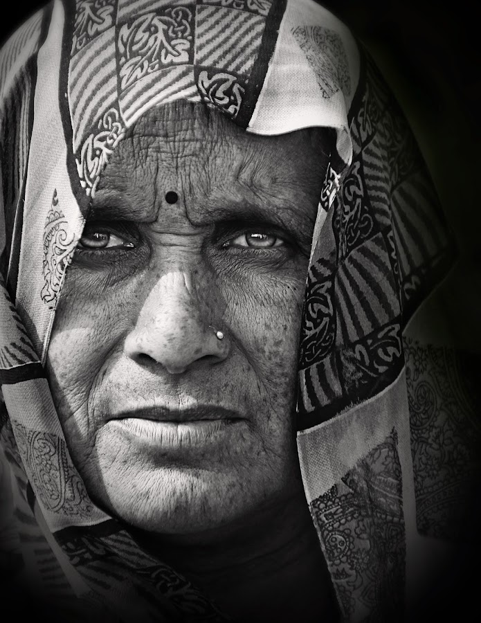 The Glance by Pronab Kundu - People Portraits of Women ( journalism, face, black and white, street photography )