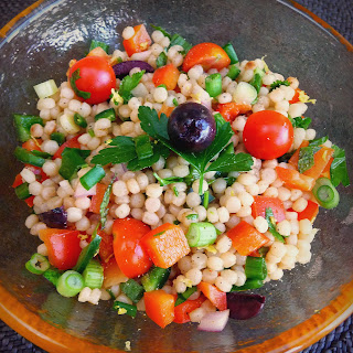 Pearl Couscous Salad with Tomatoes, Peppers, Mint and Cilantro.