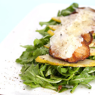 Baby arugula salad with warm shiitake mushrooms, pears, Parmesan shavings and white truffle oil.