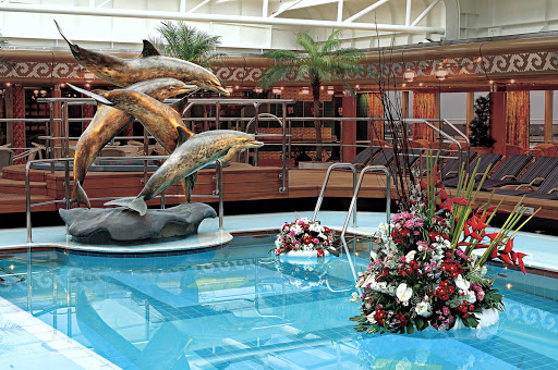 Holland-America-Vista-Class-Lido-Pool-Midship - The sculptural figure of dolphins at the Lido Pool aboard Holland America's Westerdam, Noordam, Oosterdam and Zuiderdam.