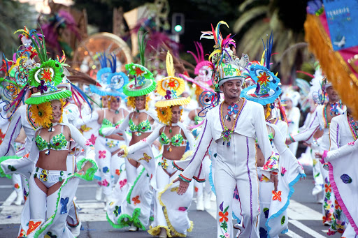 Ornately costumed dancers on parade at the Carnival of Santa Cruz de Tenerife in the Canary Islands. The festival is held in February each year and attracts visitors from around the world.