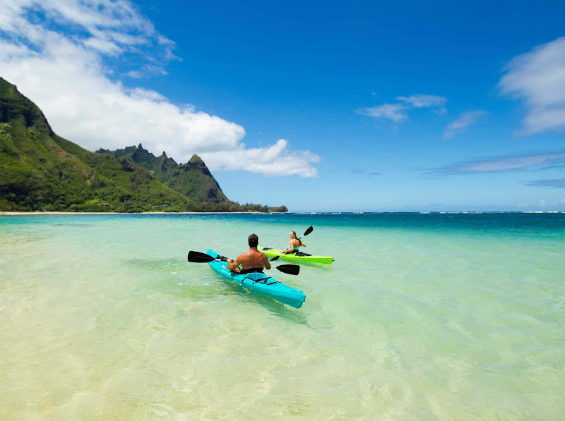A couple kayaks at Makua Beach in Hanalei, Kauai.