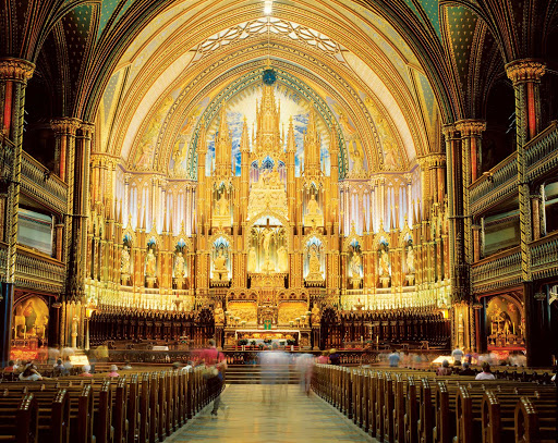 The majestic interior of Notre-Dame Basilica in Old Montreal.